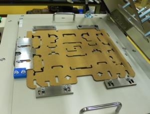 コの字折り装置